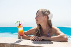Woman drinking tropical cocktail. At  beach resort Stock Photo