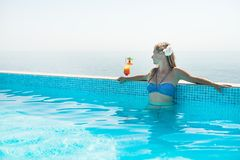 Woman drinking tropical cocktail. At  beach resort Royalty Free Stock Image