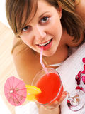 Woman drinking tropical drink Stock Image