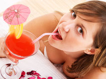 Woman drinking tropical drink Stock Images
