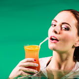 Woman drinking tropical drink in water. Stock Photography