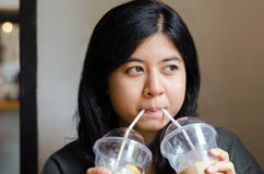 Woman drinking a two cups of coffee Stock Photos