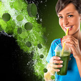 Woman drinking vegetable smoothies. Stock Photography