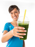 Woman drinking vegetable smoothies. Stock Image