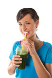 Woman drinking vegetable smoothies. Royalty Free Stock Photos
