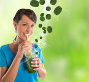 Woman drinking vegetable smoothies. Royalty Free Stock Photography
