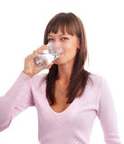 Woman drinking water. Young woman drinking water from a glass Royalty Free Stock Image