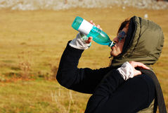 Woman drinking water Stock Images