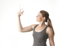 Woman drinking water. Fit, youthful young woman drinking water Stock Photos