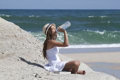 Woman drinking water Royalty Free Stock Image