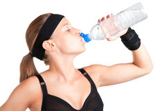 Woman Drinking Water. From a plastic bottle, isolated in white Stock Photo