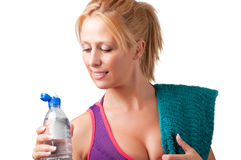 Woman Drinking Water. Woman about to drink water from a plastic bottle, isolated in white Stock Photos