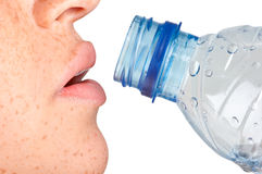 Woman Drinking Water. From a plastic bottle, isolated in white Stock Images