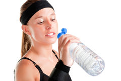 Woman Drinking Water. From a plastic bottle, isolated in white Stock Photography