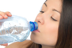 Woman drinking water from blue aqua bottle Royalty Free Stock Photography