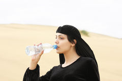 Woman drinking water from bottle Stock Photo