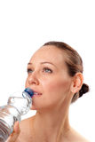 Woman drinking water from bottle Stock Images
