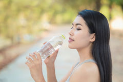 Woman drinking water. From Bottle Royalty Free Stock Photos