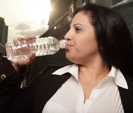 Woman drinking from a water bottle Royalty Free Stock Photo
