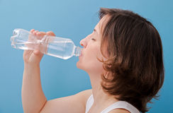 Woman drinking water from a bottle Royalty Free Stock Image