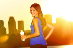 Woman drinking water city running in Montreal Stock Photography