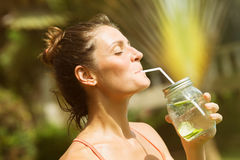 Woman Drinking Water Detox Dressed In Sports Clothes Stock Image