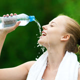 Woman drinking water after exercise Stock Photography