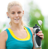 Woman drinking water after exercise Royalty Free Stock Images