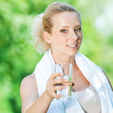 Woman drinking water after exercise Stock Images