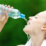 Woman drinking water after exercise Royalty Free Stock Photography