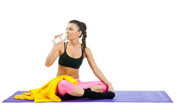 Woman drinking water after exercise Royalty Free Stock Photo