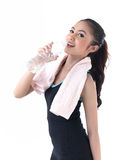 A woman drinking water after exercise Stock Photos