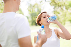 Woman drinking water after exercise Royalty Free Stock Photos