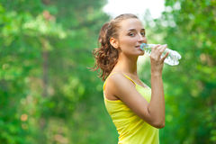 Woman drinking water after fitness Royalty Free Stock Photos