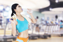 Woman drinking water at fitness center Royalty Free Stock Photo
