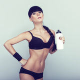 woman drinking water after fitness exercise Royalty Free Stock Image