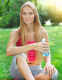 Woman drinking water after fitness exercise Stock Photography