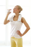 Woman drinking water after fitness workout Royalty Free Stock Images