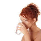 Woman drinking water from glass Stock Photography