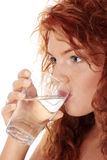 Woman drinking water from glass. Young caucasian woman drinking water from glass, isolated on white stock images
