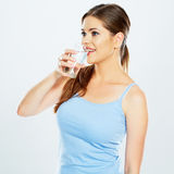 Woman drinking water with glass . Isolated portrait on white background stock image