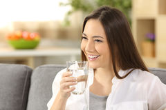Woman drinking water from a glass Royalty Free Stock Photo