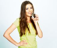 Woman drinking water of glass. Female model portrait on white background royalty free stock image