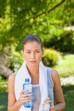 Woman drinking water after the gym Royalty Free Stock Photography