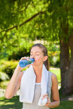 Woman drinking water after the gym Royalty Free Stock Images