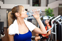Woman drinking water in the gym Royalty Free Stock Photo