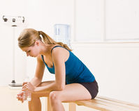 Woman drinking water in health club Royalty Free Stock Image