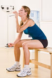 Woman drinking water in health club Royalty Free Stock Photos