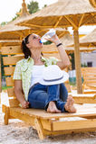 Woman drinking water hot summer Royalty Free Stock Images