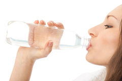 Woman drinking water, isolated Stock Images